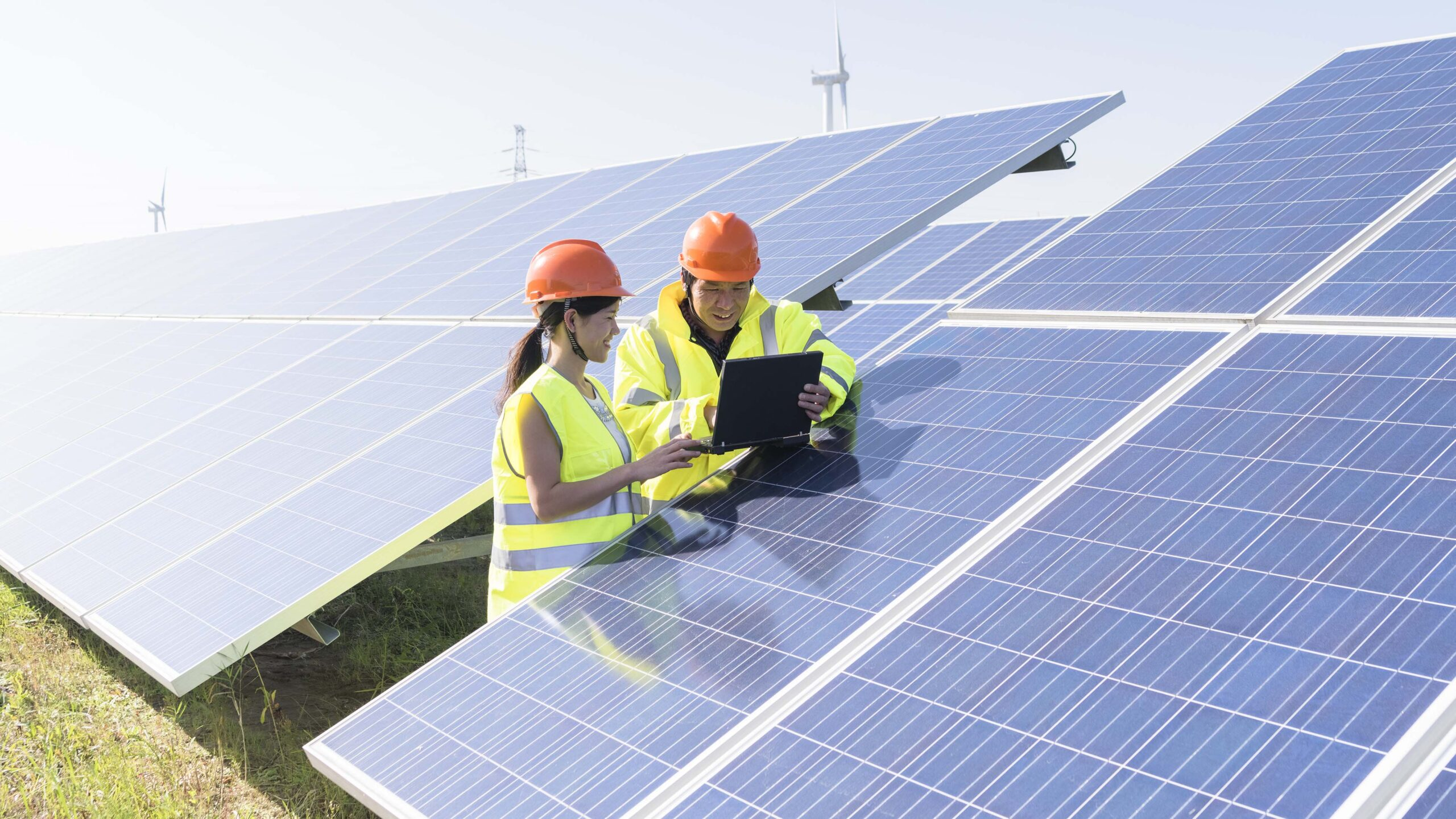 two workers at a renewable energy plan.